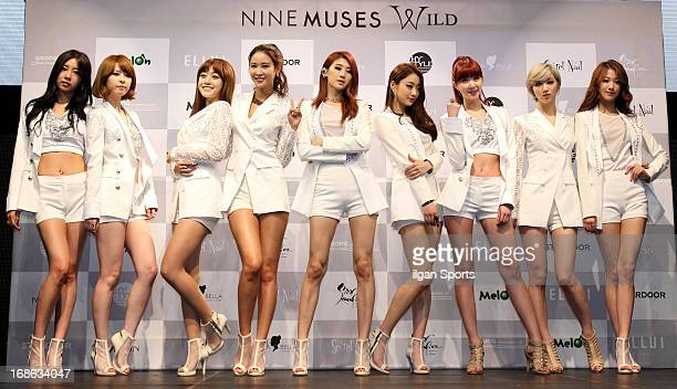 Nine Muses pose for photographs during their mini album 'Wild' showcase at Club Ellui on May 8 2013 in Seoul South Korea