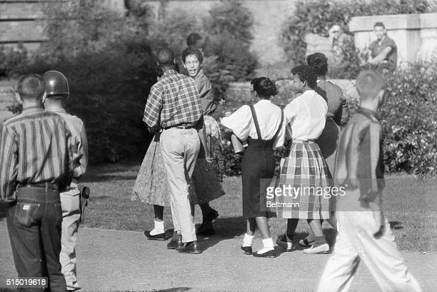 Nine Negro students entered Little Rock Central High School for the fifth straight day as federalized National Guard troops took over patrolling...