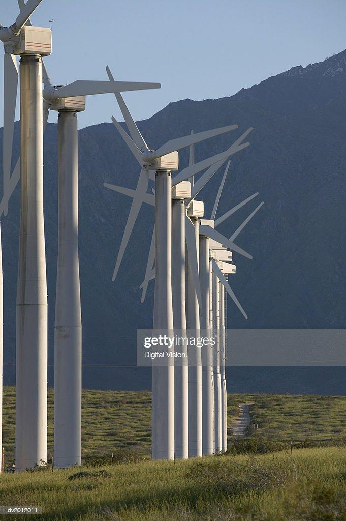 Nine Wind Turbines in a Row : Stock Photo