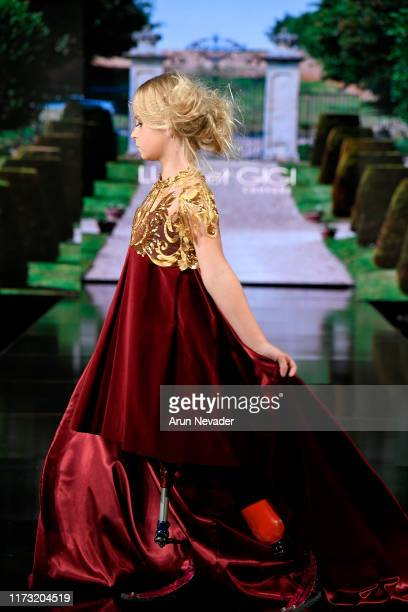 Nine year old British double amputee DaisyMay Demetre walks the runway during LULU ET GIGI Couture at New York Fashion Week Powered by Art Hearts...