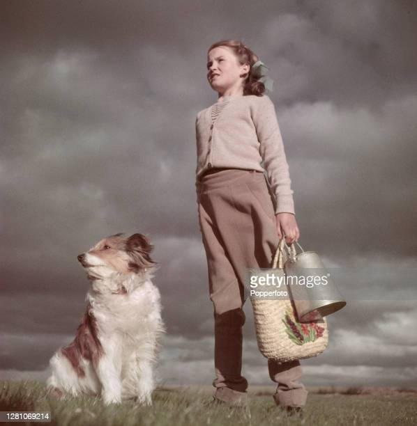 Nine year old Judith Chapman a farmer's daughter from Comberton near Cambridge posed with her dog 'Fiddy' on the family farm in Cambridgeshire...