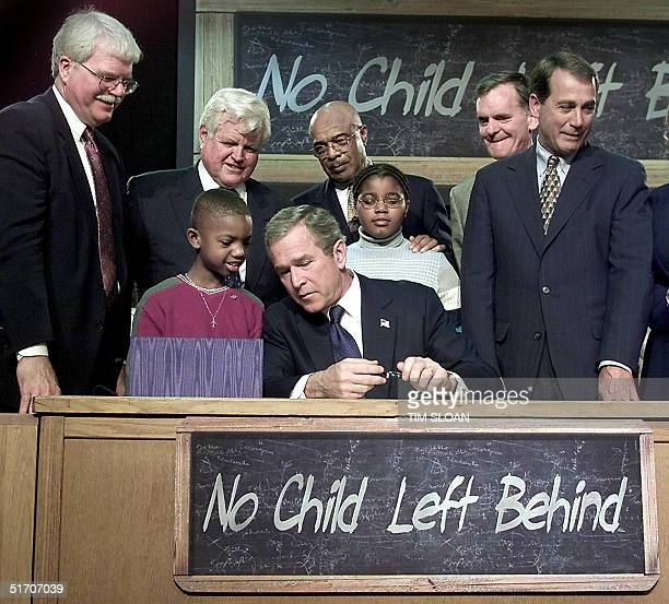 Nine year old Tez Taylor asks US President George W Bush a question during a bill signing ceremony of the 'No Child Left Behind' Act an education...