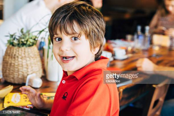 nine years old child looking at camera and laughing (indoors) - 8 9 years stock pictures, royalty-free photos & images