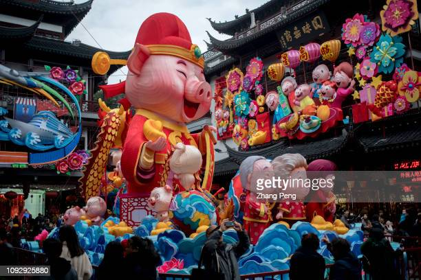 A ninemeter high cartoon pig lantern on the central square of Shanghai Yu Garden Shanghai Yu Garden lantern festival is a historic folk activity to...