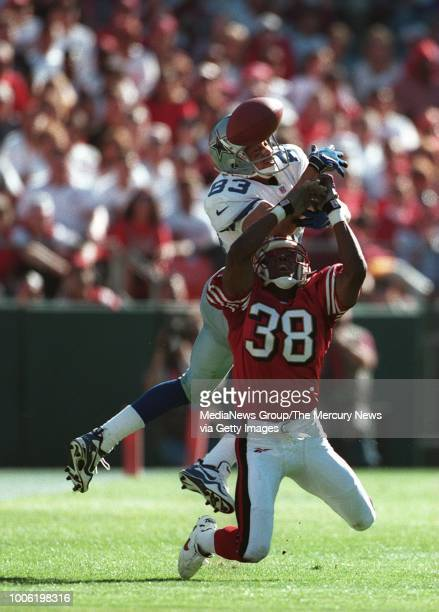 Niners cornerback Darnell Walker deflects the Aikman pass intended for Dallas' Anthony Miller during second quarter action