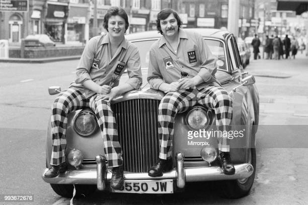 Nineteen year old dart player Eric Bristow poses in London sitting on top of a Rolls Royce beside current world champion Alan Glazier 6th March 1977