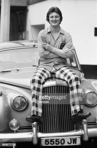 Nineteen year old dart player Eric Bristow poses in London sitting on top of a Rolls Royce, 6th March 1977.