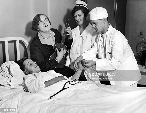 Nineteen year old Kate Smith of the Honeymoon Lane Theater Company provides melodious syncopation as Dr O Dannenbrink of Lexington Hospital performs...