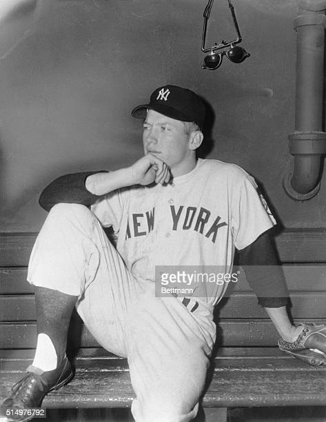Nineteen year old Mickey Mantle rookie outfielder for the New York Yankees is pictured here sitting on bench prior to playing left field in today's...