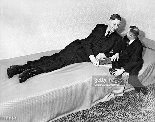 Nineteen year old Robert Wadlow of Alton Illinois chatting with a friend after appearing at a charity event Omaha Nebraska April 1 1937 He was eight...
