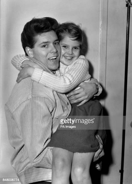 Nineteen year old singing star Cliff Richard gives his sister Joan a farewell hug at Heathrow Airport as he was about to board a Pan American Clipper...