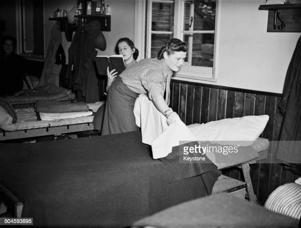 Nineteen year-old Mary Spencer-Churchill , youngest daughter of British Prime Minister Winston Churchill, making her bed at an ATS reception depot in...