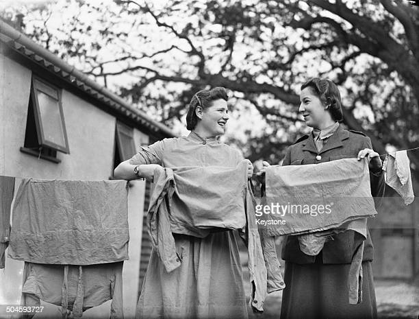 Nineteen yearold Mary SpencerChurchill youngest daughter of British Prime Minister Winston Churchill hanging out washing at an ATS reception depot in...