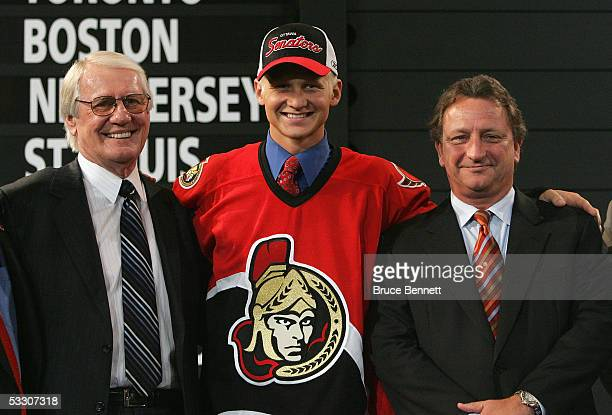 Nineth overall draft pick Brian Lee of the Ottawa Senators poses with general manager John Muckler and owner Eugene Muckler after being selected...