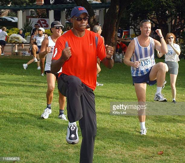 Ninetime Olympic track and field gold medalist Carl Lewis warms up with runners at Library Park in El Seguindo Calif on Sunday July 13 2003 Lewis...