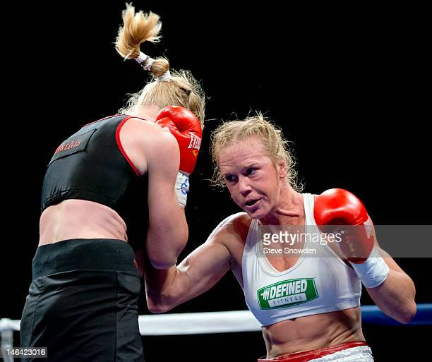 Ninetime threedivision world women's boxing champion Holly Holm trades punches with Anne Sophie Mathis at Route 66 Casino's Legends Theater on June...