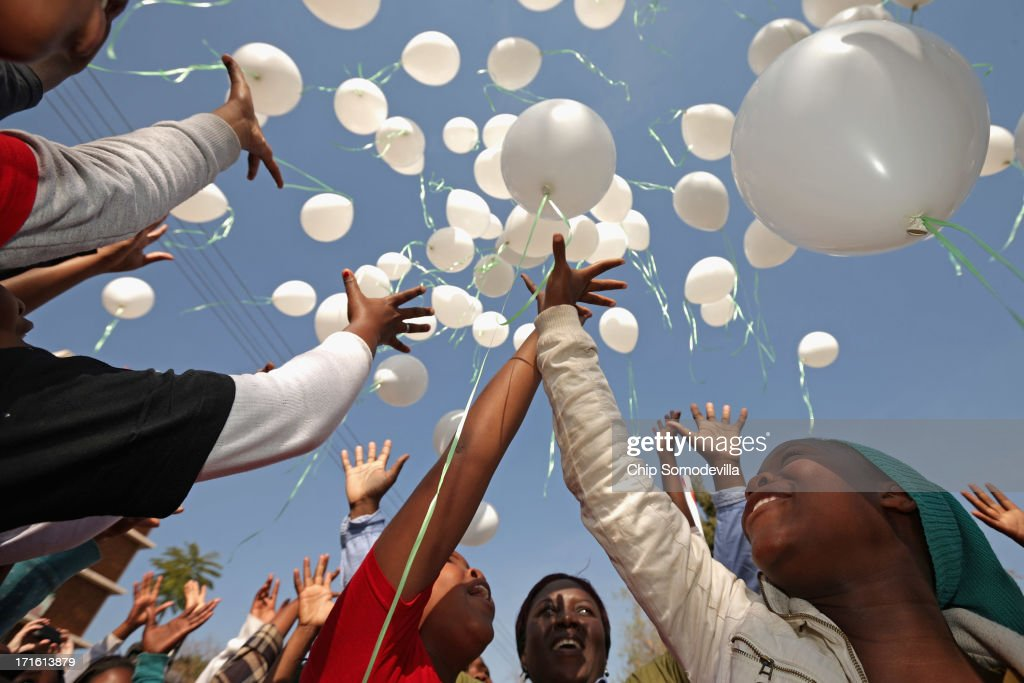 Ninetly-five children release 95 balloons after praying for former President Nelson Mandela to mark the upcoming of his 95th birthday outside the Mediclinic Heart Hospital where Mandela is being treated for a recurring lung infection June 27, 2013 in Pretoria, South Africa. Family members and President Jacob Zuma have visited Mandela in the hospital today.