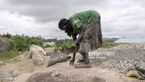 Ninety fouryearold grand mother Azumi Atang pick stones she she has shattered with a hammer to make a living on a hill in Jos Plateau State in...