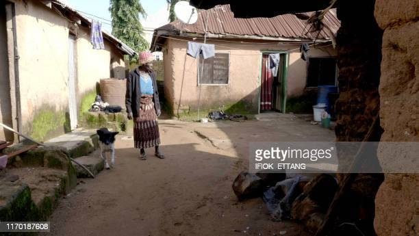 Ninety fouryearold grand mother Azumi Atang relaxes at home after breaking stones to make a living in Jos Plateau State in central Nigeria on...