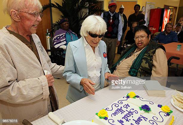Ninety oneyearold Edith Shain looks at a cake while meeting with veterans at the San Francisco VA Medical Center April 20 2010 in San Francisco...