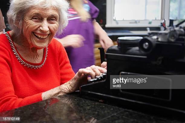 Ninety year lady on old typewriter