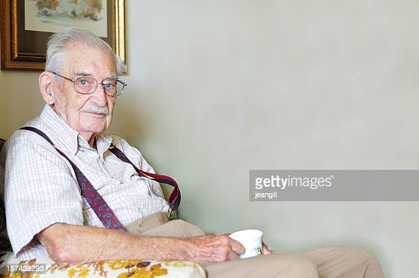 ninety year old man with mug of tea - suspenders stock pictures, royalty-free photos & images