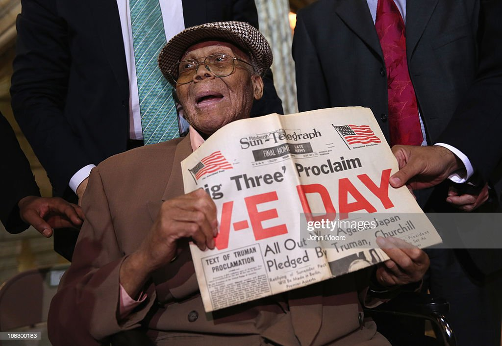 Ninety year-old WWII veteran Willie Wilkins shows a newspaper on the 68th Victory in Europe Day at the Newark City Hall on May 8, 2013 in Newark, New Jersey. Newark Mayor Cory Booker, who has declared that he will run for New Jersey's open U.S. Senate seat in 2014, honored the 90-year-old WWII veteran on the 68th anniversary of Victory in Europe Day. At the ceremony, Wilkins was returned his dog tags, which were recently unearthed in a French garden, some 67 years after he lost them in France during WWII.