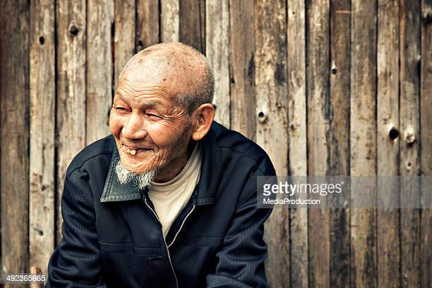 ninety years old chinese man - bad teeth stock photos and pictures
