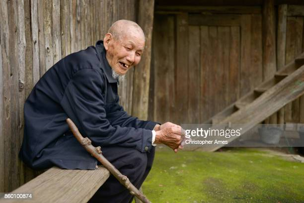 Ninety Years Old Chinese Man Sitting Alone