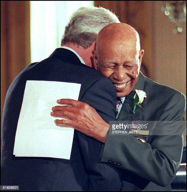 Ninetyfouryearold Herman Shaw embraces US President Bill Clinton after receiving a public apology for being victimized in the Tuskegee Syphilis Study...