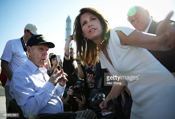 Ninety-six-year-old World War II veteran Eugene Morgan of West Memphis, Arkansas, listens to U.S. Rep. Michele Bachmann as Rep. John Carter looks on...