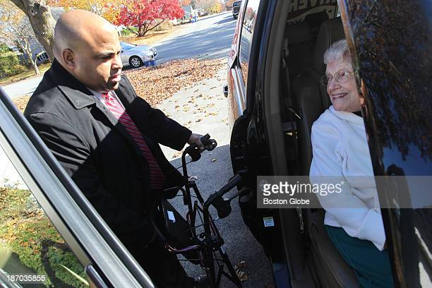 Ninetytwo year old Elizabeth Fallisi of Lawrence gets a lift to the polling station from mayoral candidate Daniel Rivera on Tuesday morning Fallisi...