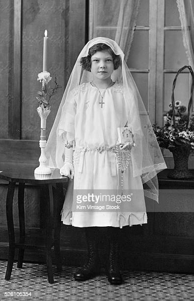 Nineyear old girl poses for her first communion portrait ca 1929