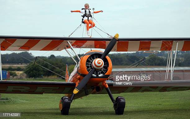 Nineyear Rose Brewer prepares to wingwalk over Rendcomb airfield in Gloucestershire to become one of the world's youngest formation wingwalkers on...