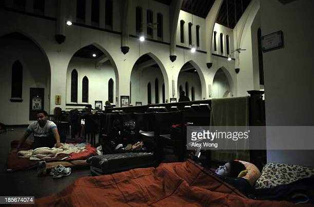 Nineyearold Alan Espinoza of Phoenix Arizona plays video games on a tablet computer as he spends the night with other immigration reform activists on...
