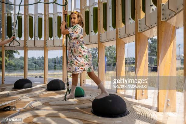 Nine-year-old Anielka plays in an AirBubble, an innovative playground providing clean air thanks to algae that absorb pollutants and carbon dioxide...