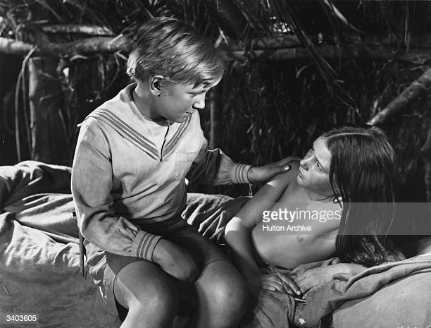 Nineyearold Australian actress Susan Stranks and Irish child actor Peter Jones play two marooned children in the film 'The Blue Lagoon' shot on...