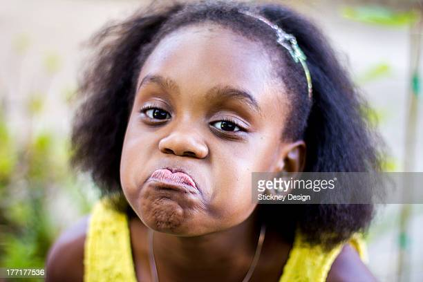 nine-year-old black girl making a funny face - funny black girl ストックフォトと画像