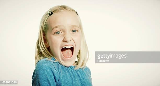Nine-year-old blonde girl screaming in terror