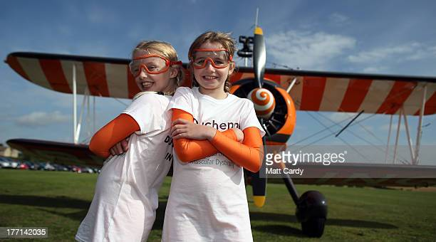 Nineyearold cousins Rose Brewer and Flame Brewer prepare to wingwalk over Rendcomb airfield in Gloucestershire to become the world's youngest...