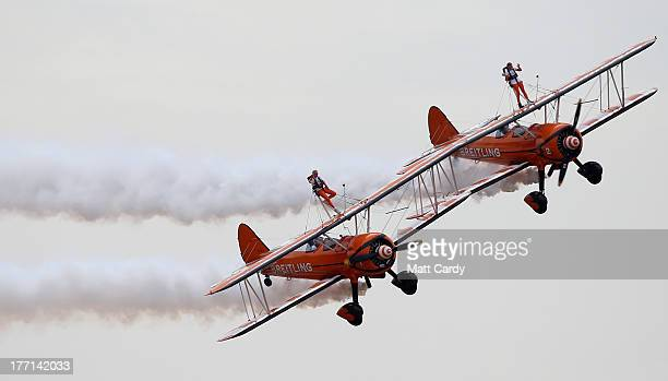 Nineyearold cousins Rose Brewer and Flame Brewer wingwalk over Rendcomb airfield in Gloucestershire to become the world's youngest formation...