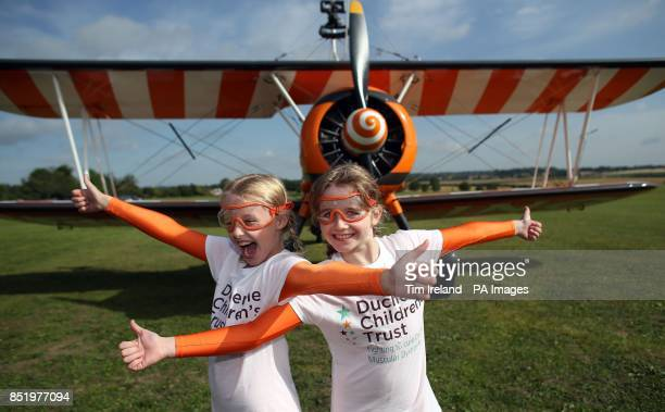 Nineyearold cousins Rose Powell and Flame Brewer prepare to go wingwalking over Rendcomb Airfield near Cirencester for the charity Duchenne...