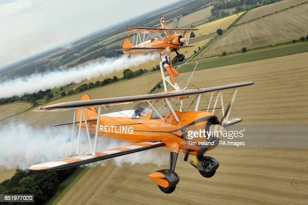 Nineyearold cousins Rose Powell and Flame Brewer wingwalking over Rendcomb Airfield near Cirencester for the charity Duchenne Children's Trust...