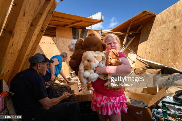 Nineyearold Keeley Frank holds some stuffed animals her grandparents Al and Barb Scheidegger salvaged from their storage unit on May 23 2019 in...