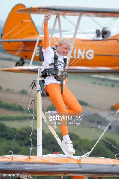 Nineyearold Rose Powell wingwalking over Rendcomb Airfield near Cirencester for the charity Duchenne Children's Trust becoming the World's one of the...