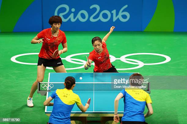 Ning Ding and Liu Shiwen of China compete against Yihan Zhou and Tianwei Feng of Singapore during the Table Tennis Women's Team Round Semi Final...