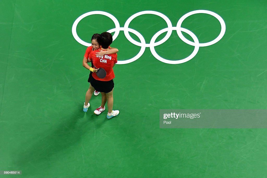 Ning Ding and Shiwen Liu of China celebrate winning gold in the their doubles match against Petrissa Solja and Xiaona Shan of Germany in the Women's Team Gold Medal Team Match between China and Germany on Day 11 of the Rio 2016 Olympic Games at Riocentro - Pavilion 3 on August 16, 2016 in Rio de Janeiro, Brazil.