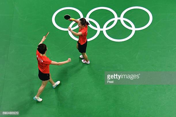 Ning Ding and Shiwen Liu of China celebrate winning gold in the their doubles match against Petrissa Solja and Xiaona Shan of Germany in the Women's...