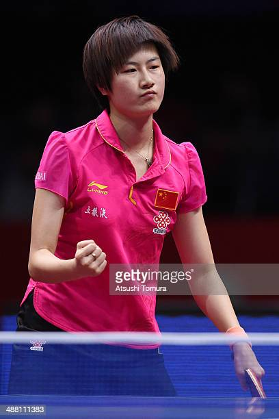 Ning Ding of China celebrates a point against Mengyu Yu of Singapore during day seven of the 2014 World Team Table Tennis Championships at Yoyogi...
