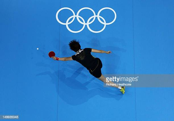 Ning Ding of China competes against Kasumi Ishikawa of Japan during the Women's Team Table Tennis gold medal match on Day 11 of the London 2012...